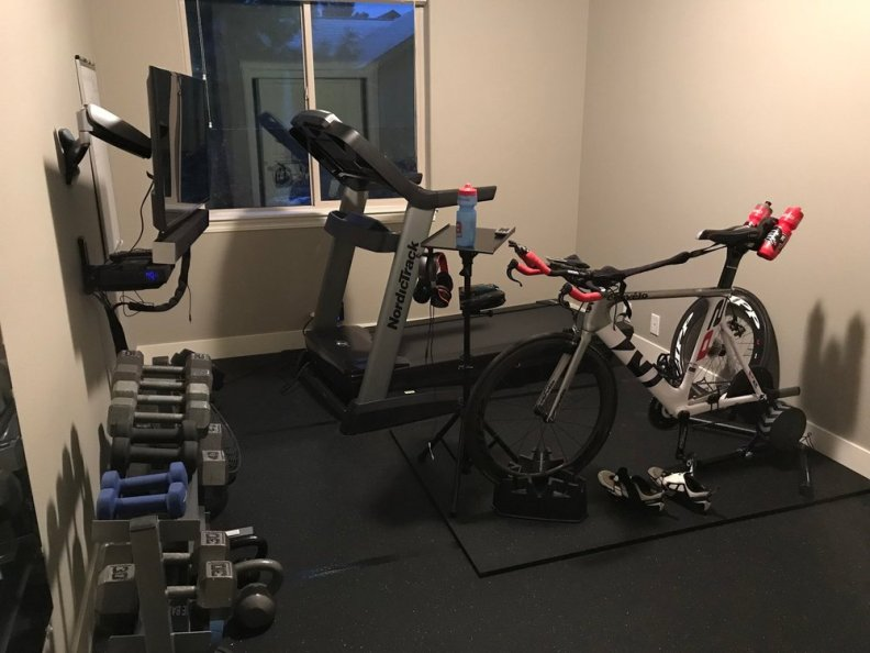 Picture of our home gym - still a work in progress. Treadmill, TT bike on Trainer, Concept 2 Rower, and a weight rack with space to lift.